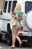 29764782-8436027-Britney_was_seen_hopping_into_her_SUV_that_appears_stocked_up_on-a-6_1592507138640.jpg