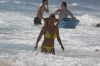 60781923_britney-spears-on-beach-in-a-yellow-bikini-in-hawaii-03-01-2018-031.jpg