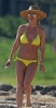 60781941_britney-spears-on-beach-in-a-yellow-bikini-in-hawaii-03-01-2018-058.jpg