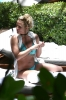 72503931_britney-spears-sunbathes-poolside-in-miami-06-06-2018_11.jpg